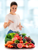 Young woman with variety of organic vegetables and fruits Stock Photo