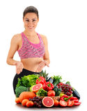 Young woman with variety of organic vegetables and fruits Royalty Free Stock Photo