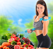 Young woman with variety of organic vegetables and fruits Stock Photos