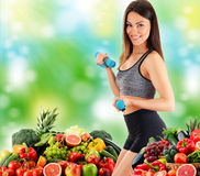 Young woman with variety of organic vegetables and fruits. Balanced diet Stock Photo