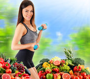 Young woman with variety of organic vegetables and fruits Stock Photography