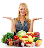 Young woman with variety of raw vegetables Royalty Free Stock Image
