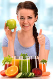 Young woman with variety of vegetable and fruit juices Royalty Free Stock Images