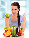 Young woman with variety of vegetable and fruit juices Stock Image