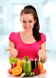 Young woman with variety of vegetable and fruit juices Royalty Free Stock Photos