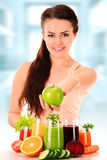 Young woman with variety of vegetable and fruit juices Stock Images