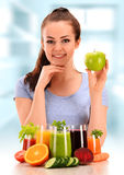 Young woman with variety of vegetable and fruit juices Stock Photos