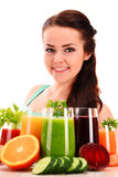 Young woman with variety of vegetable and fruit juices Royalty Free Stock Photography