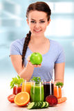 Young woman with variety of vegetable and fruit juices Stock Photography