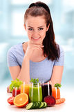 Young woman with variety of vegetable and fruit juices Royalty Free Stock Image
