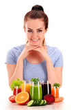 Young woman with variety of vegetable and fruit juices Royalty Free Stock Photo