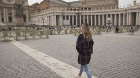 Young woman in Vatican city and St. Peter`s Basilica church, Rome, Italy. Travel tourist girl outdoors during holidays. In Europe. Slow motion. Steadycam shot stock video footage