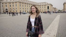 Young woman in Vatican city and St. Peter`s Basilica church, Rome, Italy. Travel tourist girl outdoors during holidays. In Europe. Slow motion. Steadycam shot stock video