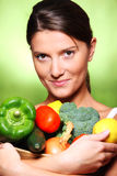 Young woman with vegetable basket Royalty Free Stock Photography