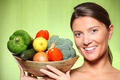 Young woman and vegetable basket Stock Images