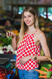 Young woman at the vegetable market Stock Images