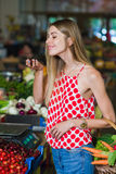 Young woman at the vegetable market Stock Image