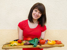 Young woman with vegetables Royalty Free Stock Images