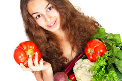 Young woman with vegetables Stock Image