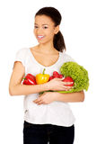 Young woman with vegetables. Royalty Free Stock Image