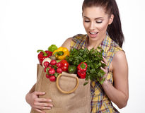 Young woman with vegetables and fruits in shopping bag Royalty Free Stock Photo