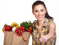Young woman with vegetables and fruits in shopping bag Stock Photo