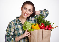 Young woman with vegetables and fruits in shopping bag Stock Photos