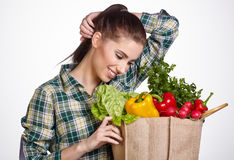 Young woman with vegetables and fruits in shopping bag Royalty Free Stock Photography