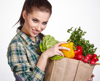 Young woman with vegetables and fruits in shopping bag Royalty Free Stock Images