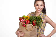 Young woman with vegetables and fruits in shopping bag Royalty Free Stock Image