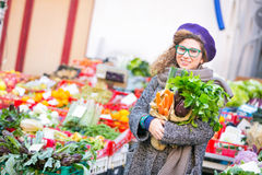 Young Woman at Vegetables Market Stock Image