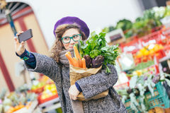 Young Woman at Vegetables Market. Young Woman Taking a Selfie at Vegetables Market Stock Image