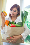 Young Woman with vegetables in shopping bag Royalty Free Stock Images