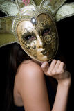 Young woman in a Venetian mask Royalty Free Stock Image