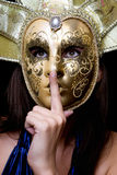 Young woman in a Venetian mask Royalty Free Stock Photos