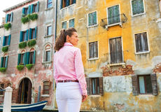 Young woman in venice, italy against old buldings Stock Photos