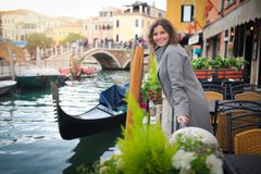 Young woman in Venice, Italy. Girl in Venice on gondolas and street canal background royalty free stock photo