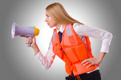 Young woman with vest and loudspeaker Stock Images