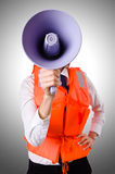 Young woman with vest and loudspeaker Royalty Free Stock Photo
