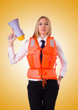Young woman with vest and loudspeaker on white Stock Photography