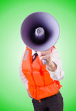 Young woman with vest and loudspeaker on white Royalty Free Stock Photo