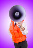 Young woman with vest and loudspeaker on white Royalty Free Stock Photography