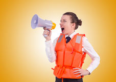 Young woman with vest and loudspeaker on white Royalty Free Stock Photos