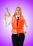 The young woman with vest and loudspeaker on white Royalty Free Stock Image