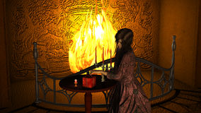 Young Woman with Victorian Dress near Fireplace opening a Gift Box Royalty Free Stock Images