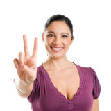 Young woman with victory sign Royalty Free Stock Photo
