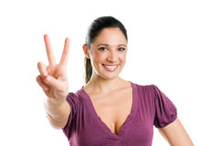 Young woman with victory sign Royalty Free Stock Photography