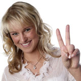 Young woman victory sign Stock Images