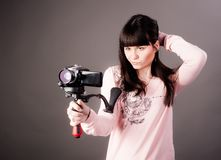 Young woman with video camera Royalty Free Stock Images