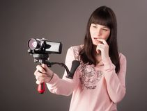 Young woman with video camera Royalty Free Stock Photography